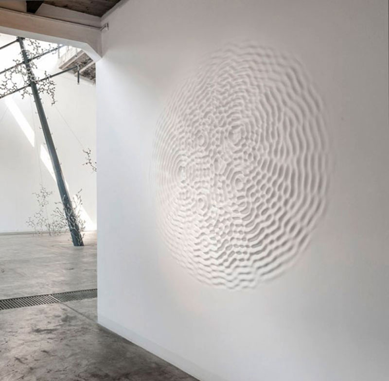 Extruding bodies Wallwave vibration (momentum wavevector chorus), 2012 poliester resin, wall paint diameter 220 cm installation view Galleria Continua, Beijing, China  photo Oak Taylor-Smith